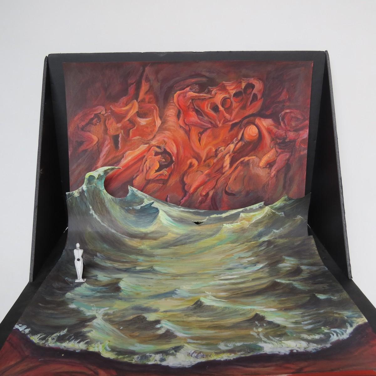 Une autre proposition sur une demande du chorégraphe de passer la matière de la toile peinte dans les tons rouges. Des pénitents fondus dans la terre poussent la matière tel Sisyphe poussant son rocher. Une mer s' amorce sur une construction en toboggan en fond de scène. Sa silhouette a jardin fait référence a la vague d'Hokusai. Cette structure toboggan permet des entrées en glissade pour les danseurs. Cette mer peinte en trompe l'oeil sur le tapis de danse vient mourir a l'avant scène dans un ourlet d' écume. Sont aspect irréelle est renforcé par une ombre portée sous l'écume qui accentue sont aspect flottant.